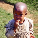 Little Baby Girl chewing some sweets