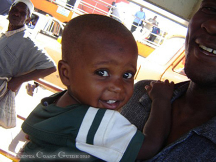 Little Boy with his dad on Likoni Ferry